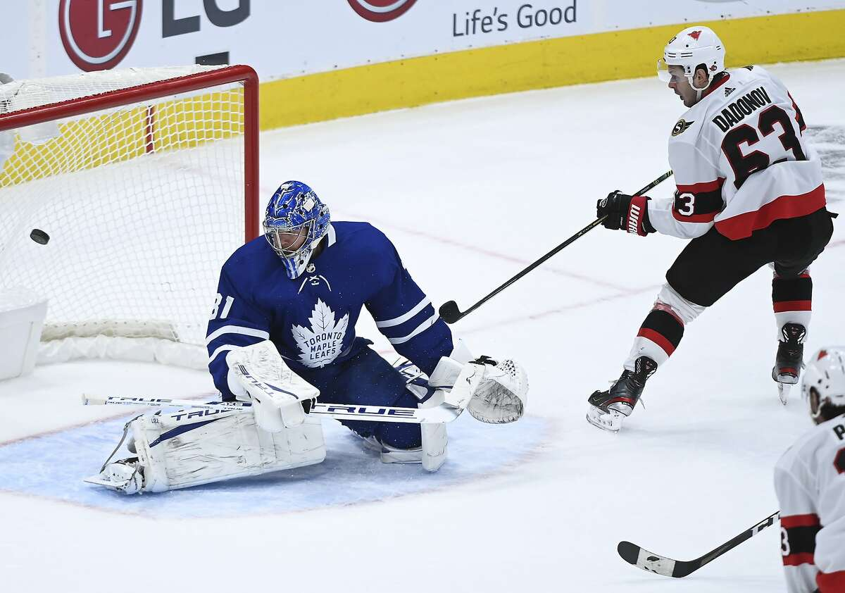 Evgenii Dadonov fires the puck past Toronto goalie Frederik Andersen in overtime to complete Ottawa's comeback.