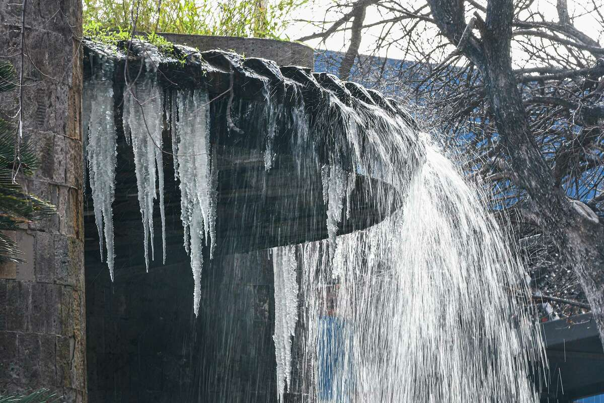 The fountain outside the BBVA Compass building partially freezes over Monday morning, Feb. 15, 2021, as Laredo experiences temperatures in the low 20s following a winter storm the night prior.
