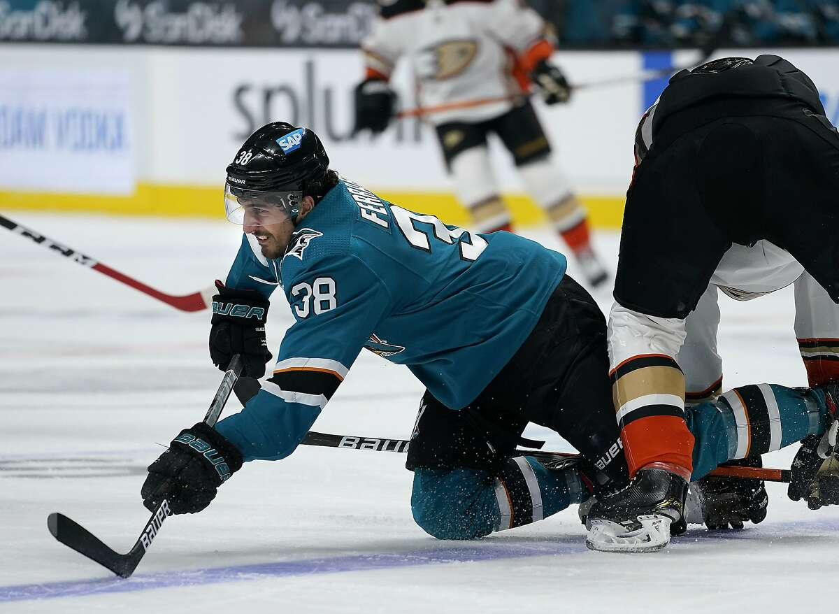 Sharks defenseman Mario Ferraro (38) reacts as he is tripped by Anaheim Ducks center Rickard Rakell during the second period of a Sharks win in San Jose.