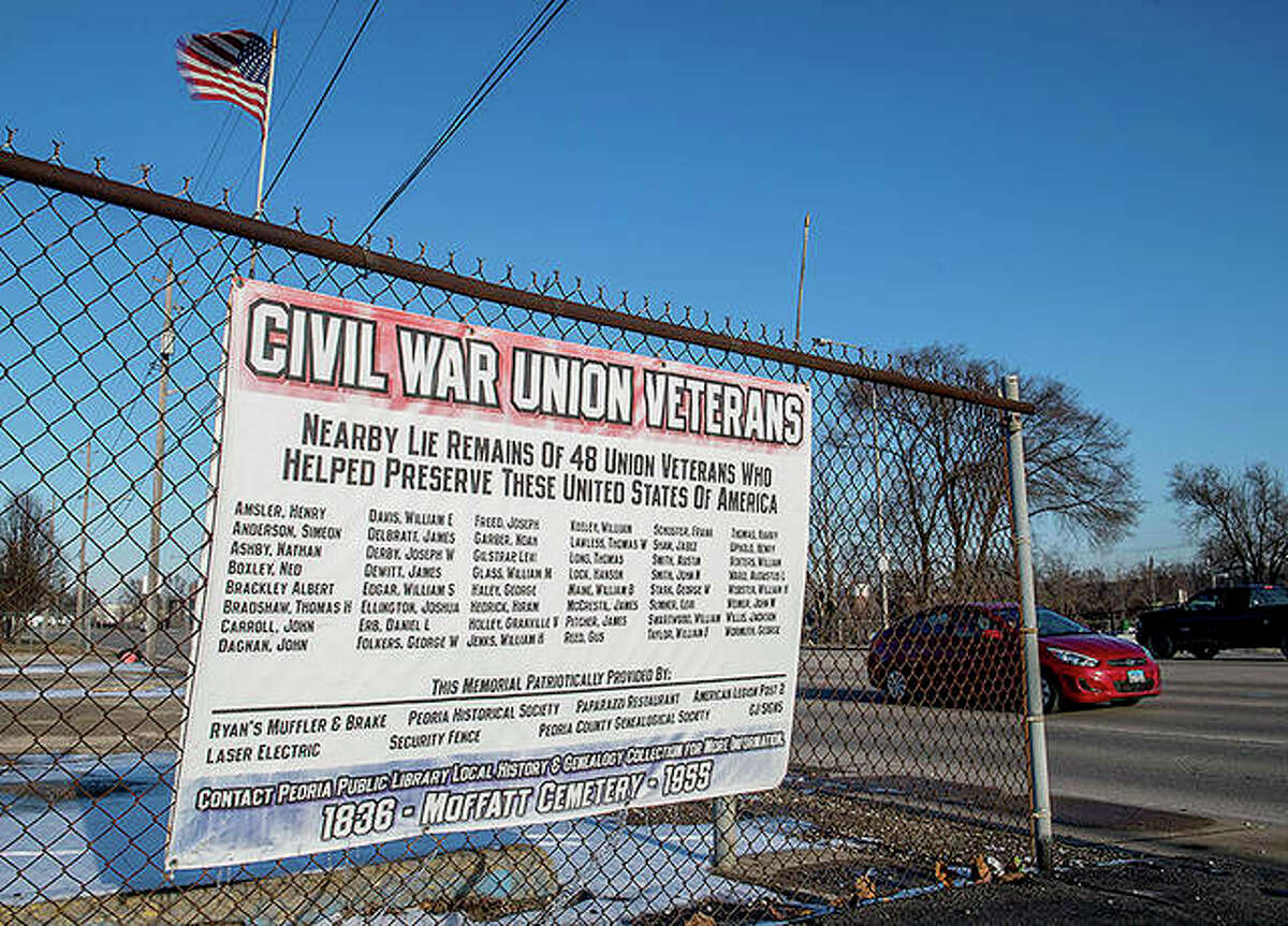 A large sign with the name of 48 Civil War veterans hangs on a fence in Peoria. The area is believed to be the final resting place of the veterans and others, including Nance Legins-Costley, the first slave legally freed by Abraham Lincoln.