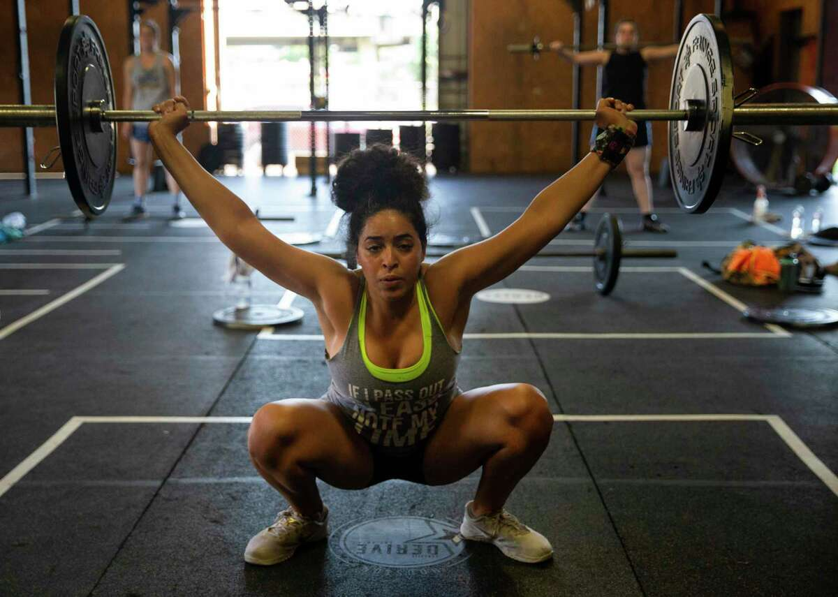 Sara Khalifa works out during a crossfit class at Derive Athletics Tuesday, June 16, 2020, in Houston. Frank Nguyen, owner and head coach of the gym, 30, disaffiliated from the Crossfit Derive brand after the now ex-CEO made comments concerning the death of George Floyd and Black Lives Matter movement.