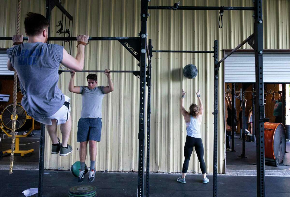 Crossfit athletes work out during a crossfit class at Derive Athletics Tuesday, June 16, 2020, in Houston. Frank Nguyen, owner and head coach of the gym, 30, disaffiliated from the Crossfit Derive brand after the now ex-CEO made comments concerning the death of George Floyd and Black Lives Matter movement.