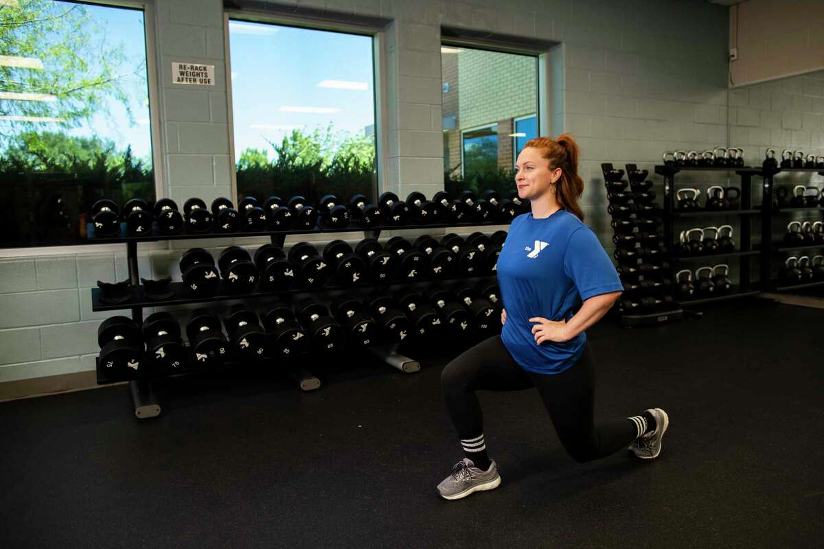 Shelby Saylor, 27, association director of healthy living Greater YMCA of Houston demonstrates lunges exercise on Thursday, April 23, 2020, in Spring Branch.