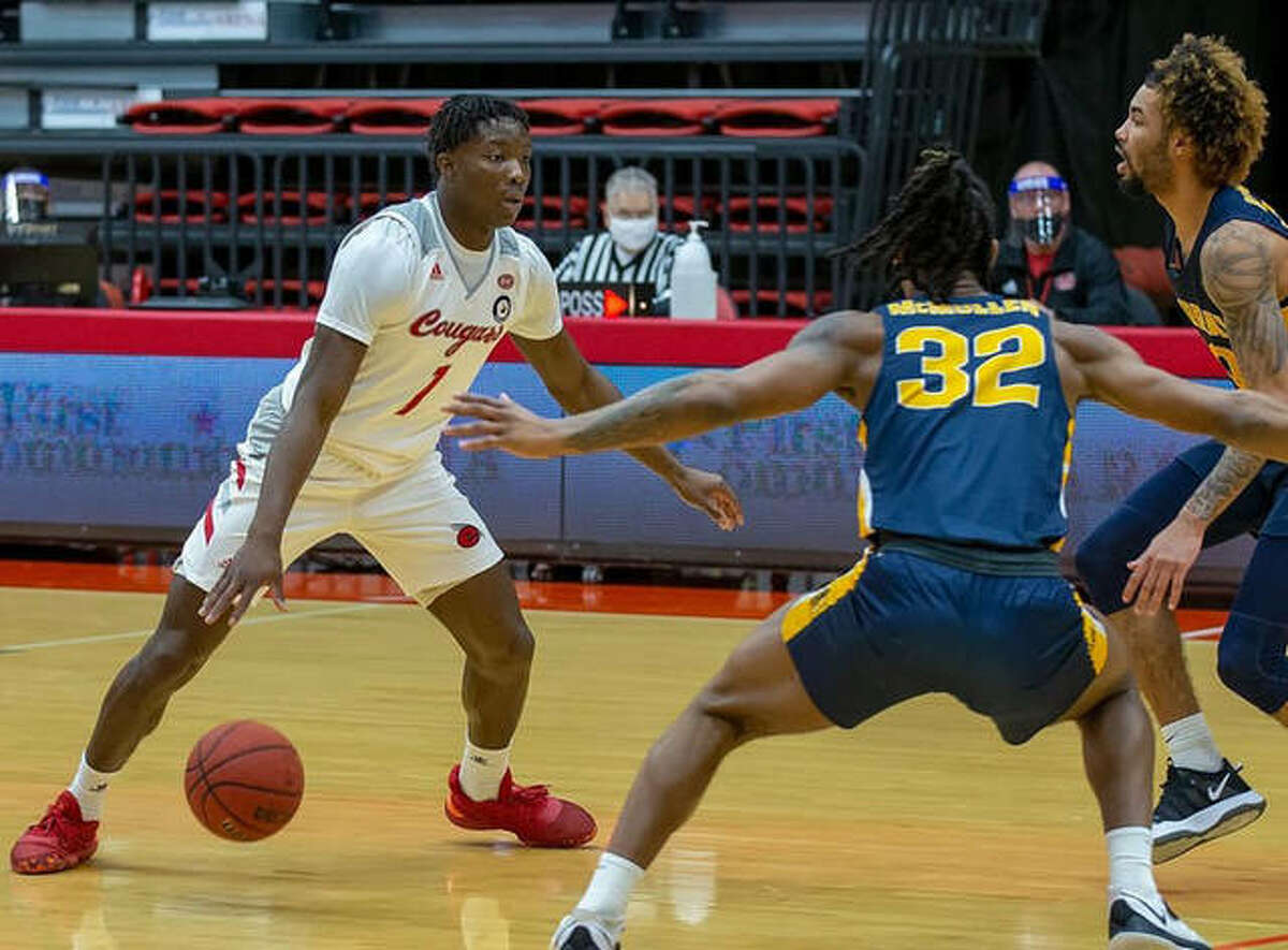 SIUE guard Mike Adewunmi looks for room against two Murray State defenders during first-half action Monday inside First Community Arena.