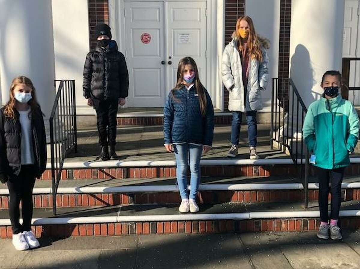 DAR fifth grade essay contest winners gathered socially distanced on the front steps of the Noroton Presbyterian Church. Second place winner Madeline Wren; front, left, first place winner Georgina Cappella; with third place winner, Noa Durocher-Pyun. At back are honorable mention winners Momo Schoenemann and Cara McElrea. The DAR usually hosts a reception at the Noroton Presbyterian Church Parlor for student winners, their parents, and teachers, but due to the pandemic this year's event was not held.