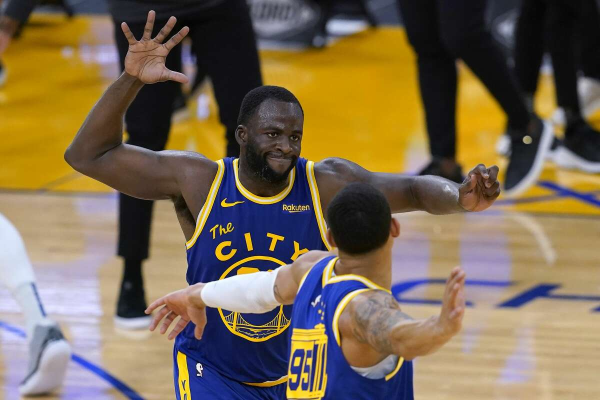 Golden State Warriors forward Draymond Green, celebrates with forward Juan Toscano-Anderson during the second half of the team's game against the Orlando Magic on Feb. 11, 2021.