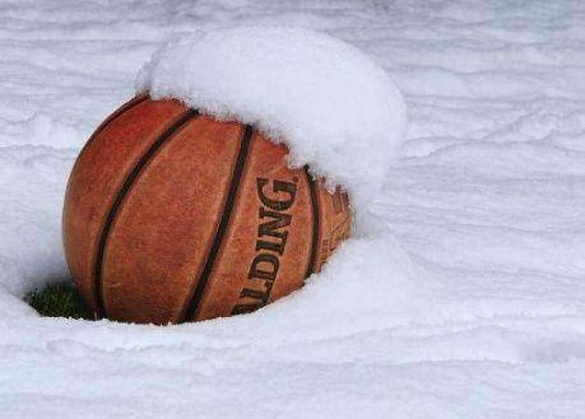 FILE - A basketball in snow.