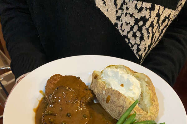 Filet mignon with peppercorn-cognac sauce, baked potato and green beans in a cook-at-home meal kit from The Wishing Well in Wilton. (Provided photo.)