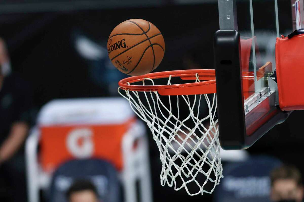 Basketball shot on the rim during an NBA basketball game between the Charlotte Hornets and the San Antonio Spurs in Charlotte, N.C., Sunday, Feb. 14, 2021. (AP Photo/Nell Redmond)