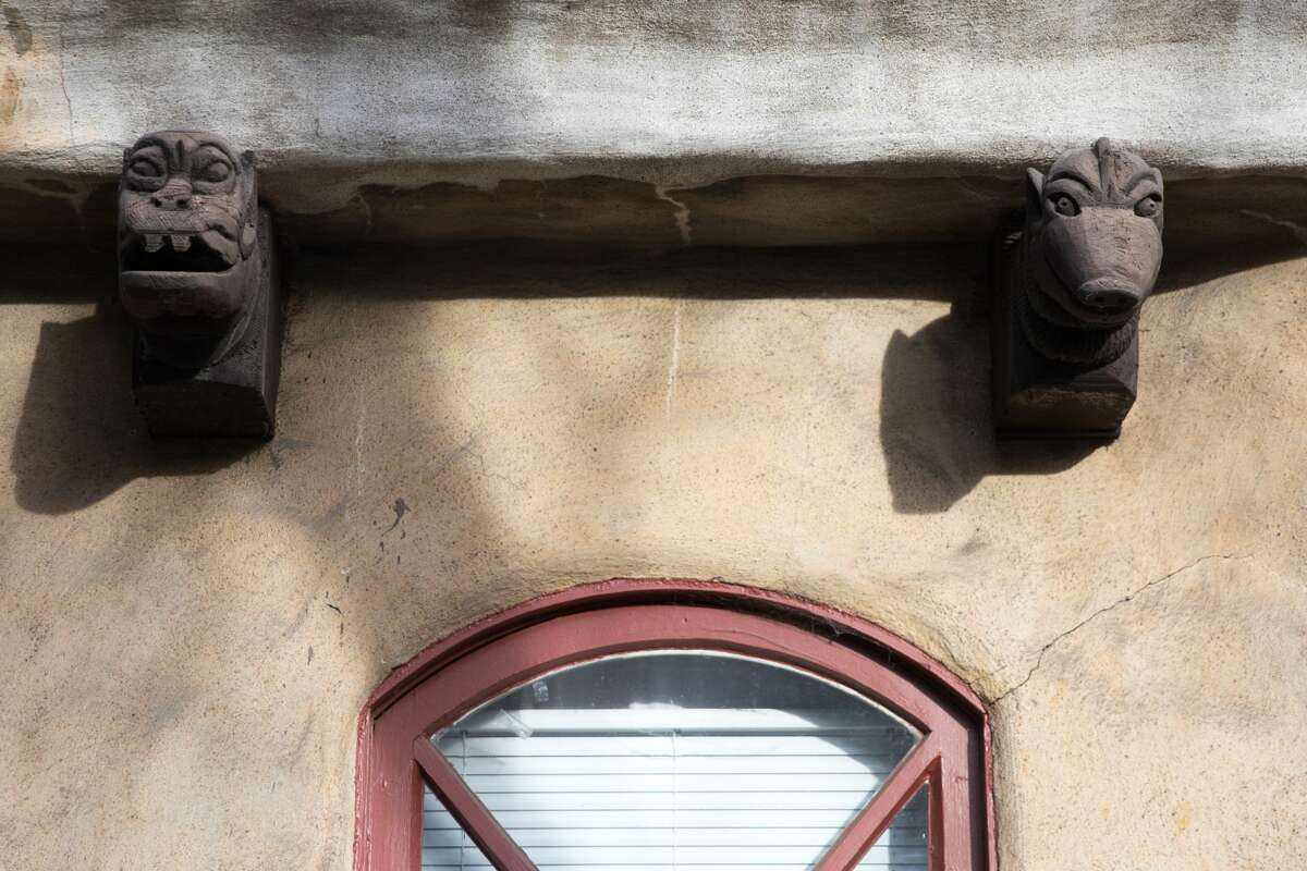 Carved grotesques (gargoyles technically spit water, which these don't) adorn the exterior of some homes.