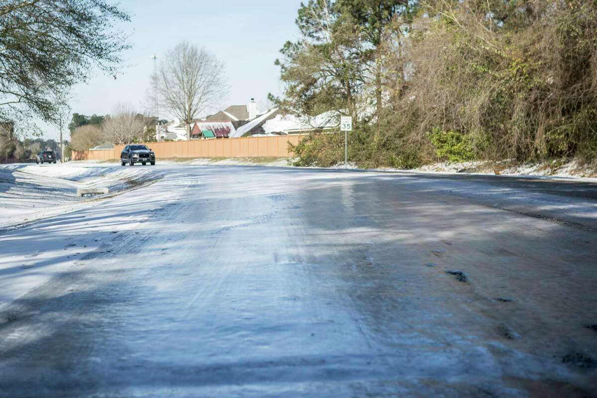 Ice covers Robinson Road and traffic continued to be light Tuesday, Feb. 16, 2021 in Conroe. Temperatures stayed below freezing Tuesday and roads remained icy.