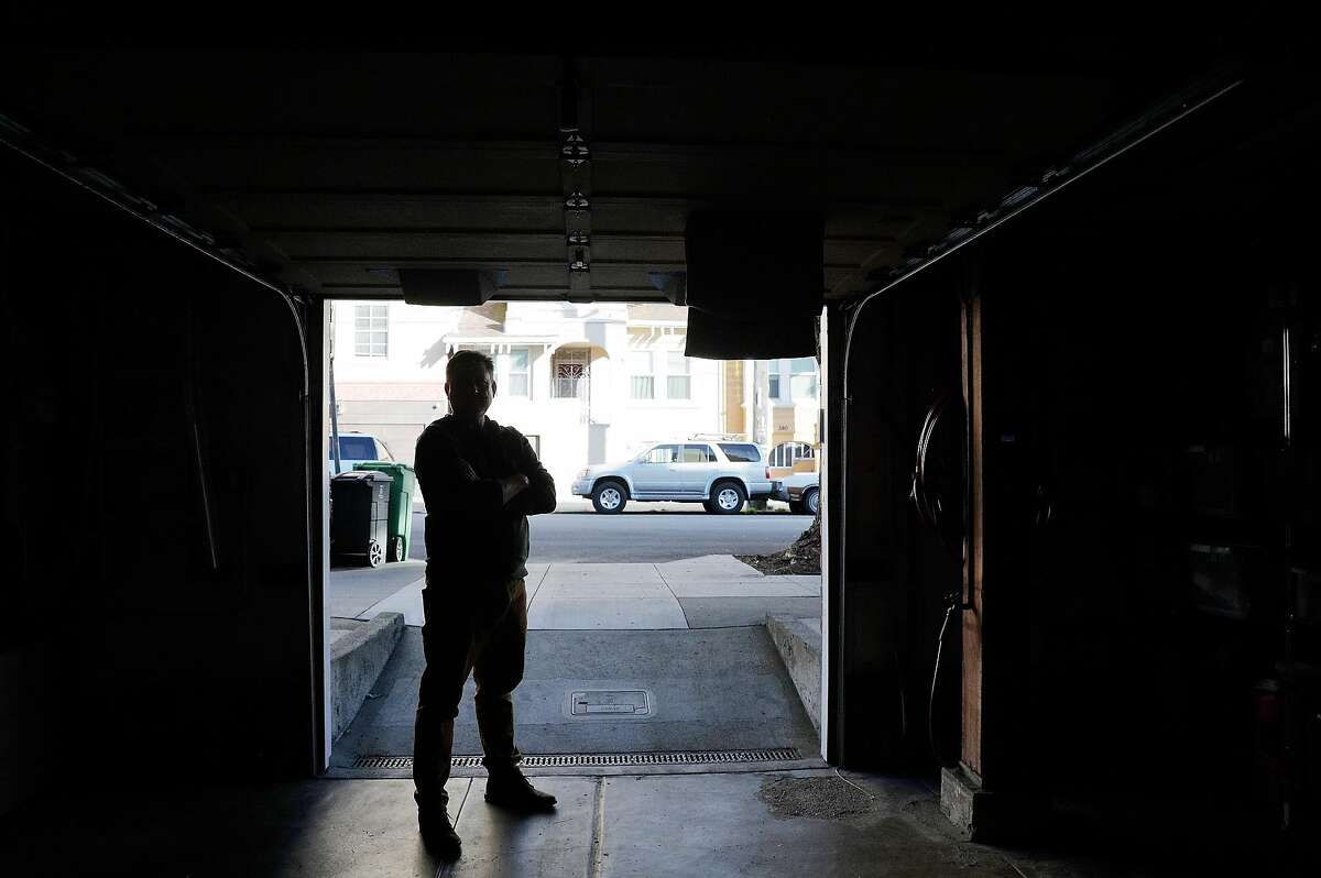 Mark Dietrich stands in his open garage door at his home in San Francisco, Calif., on Tuesday, December 22, 2020. Dietrich is a community member in the Richmond District who has taken a leadership role in helping neighbors fortify their garages amid a major spike in hot-prowl break-ins this year.