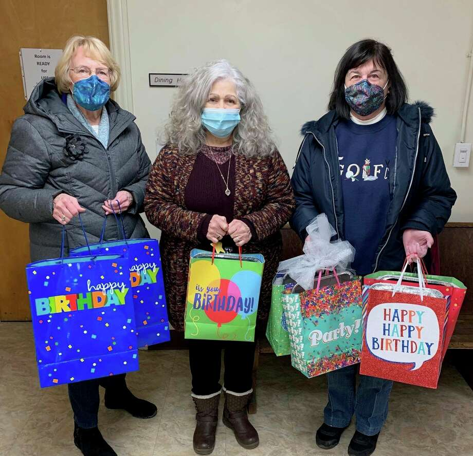 Spreading birthday cheer with bags full of goodies includes, from left, GFWC Member Melanie Henry, Diane Long, Project Starburst Executive Director and GFWC Member Pat Rossi. (Courtesy photo)
