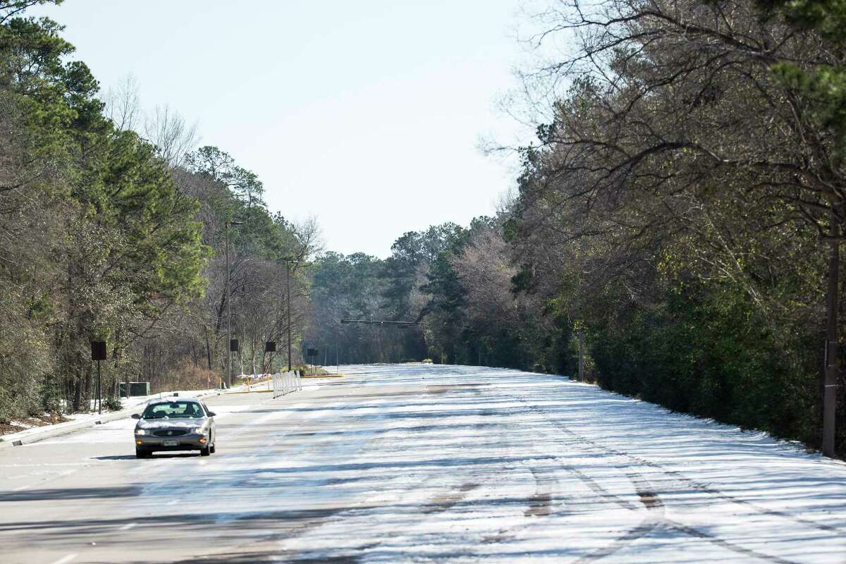 A single car drives along an empty Woodlands Parkway Tuesday, Feb. 16, 2021 in The Woodlands. Traffic continued to be light on the roadways as temperatures stayed below freezing Tuesday and roads remained icy.