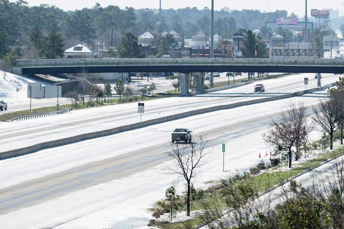 Few vehicles travel along I-45 north of Houston Tuesday, Feb. 16, 2021 in Shenandoah. Traffic continued to be light on the roadways as temperatures stayed below freezing Tuesday and roads remained icy.