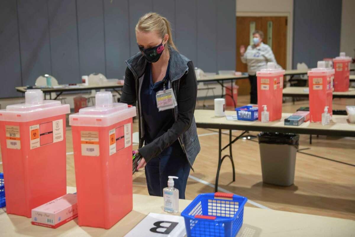 Jordann Seifert,MMH emergency room RN, distributes supplies 02/16/2021 at the new mass vaccine distribution site at Golf Course Road Church. Tim Fischer/Reporter-Telegram