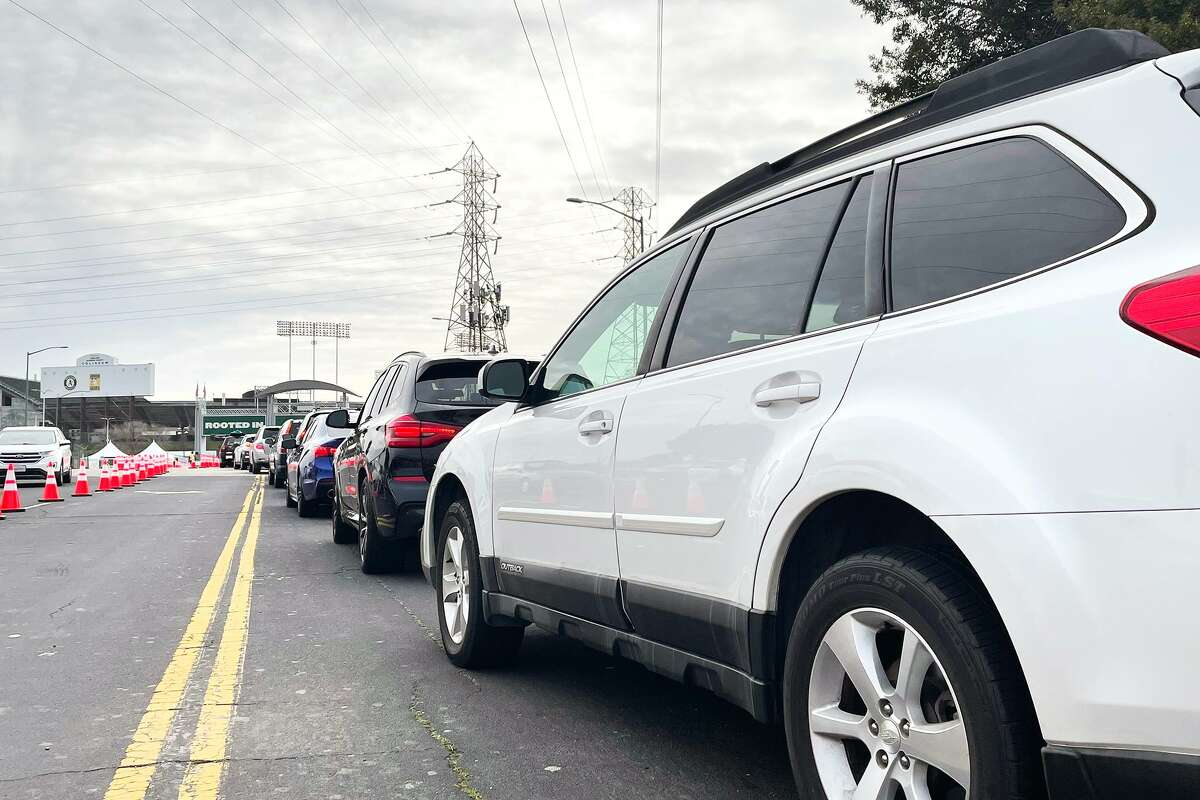 Cars were lined up in the parking lot of the Oakland Coliseum when it opened Tuesday, Feb. 16, 2021 as a mass vaccination site.