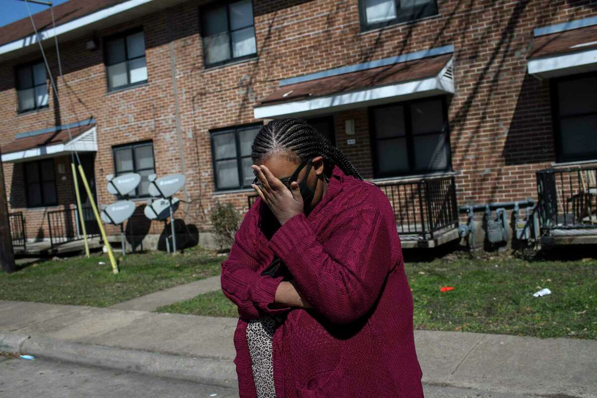 """""""I'm trying not to panic but it's hard,"""" said Alicia Carr as she wraps her sweater around her body Tuesday, Feb. 16, 2021, at Cuney Homes in Houston."""