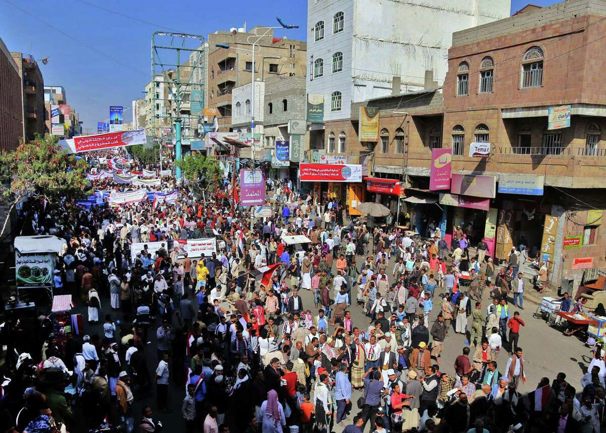 Yemenis attend a rally commemorating the 10th anniversary of 2011 Arab Spring uprising that toppled former president Ali Abdullah Saleh, in Yemen's third city of Taez on February 11, 2021.