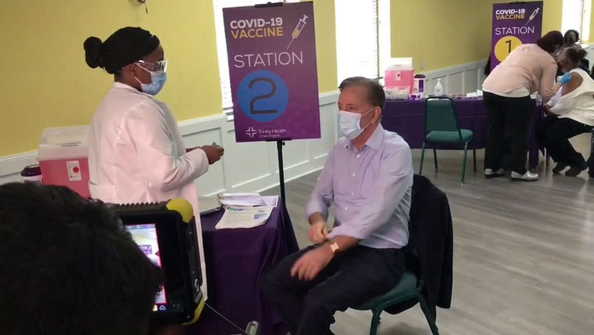 Gov. Ned Lamont receives his first COVID-19 vaccination on Feb. 16, 2021.