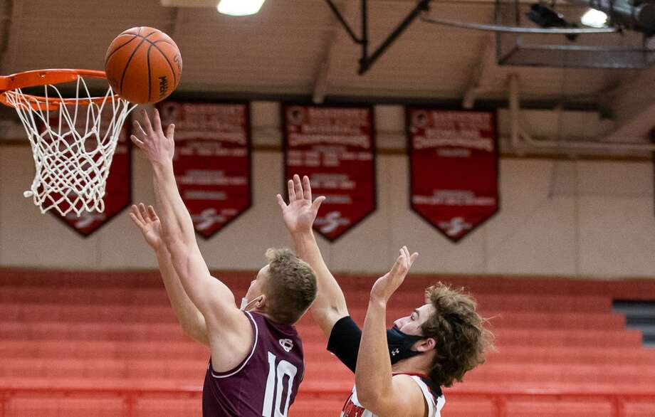 Numerous high school basketball games scheduled throughout the region for Tuesday have been postponed due to high snowfall totals. Photo: Tribune File Photo / Kaitlin's Klicks