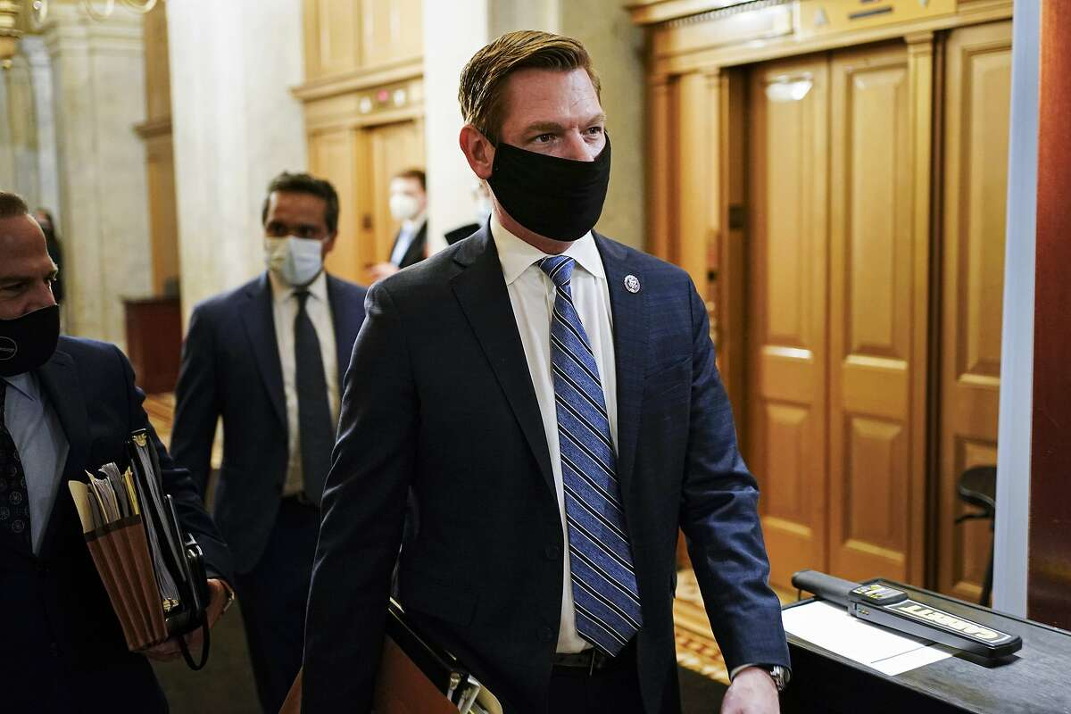 House impeachment manager Rep. Eric Swalwell, D-Calif., leaves at the end of the day of second impeachment trial of former President Donald Trump, at the Capitol, Wednesday, Feb. 10, 2021, in Washington.
