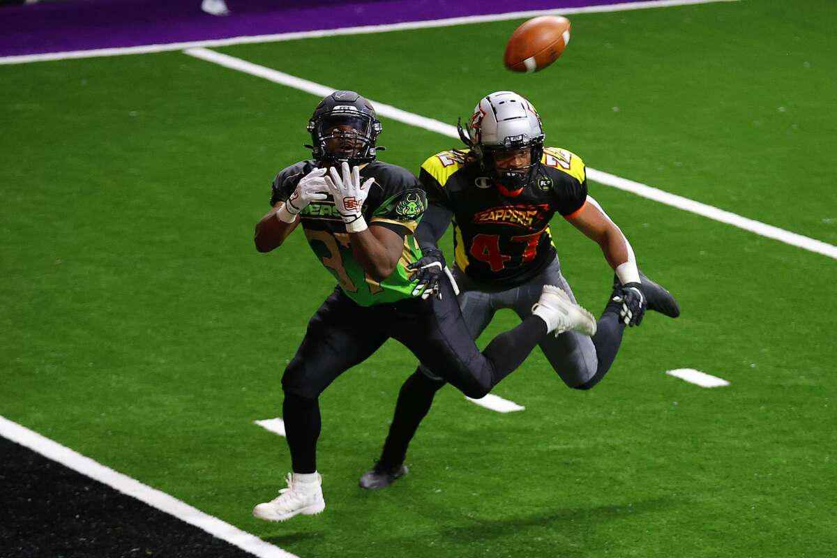 DULUTH, GEORGIA - FEBRUARY 13: LaDarius Galloway #37 of the Beasts misses a pass as James Gales Jr. #47 of the Zappers defends at Infinite Energy Arena on February 13, 2021 in Duluth, Georgia. (Photo by Kevin C. Cox/Fan Controlled Football/Getty Images)