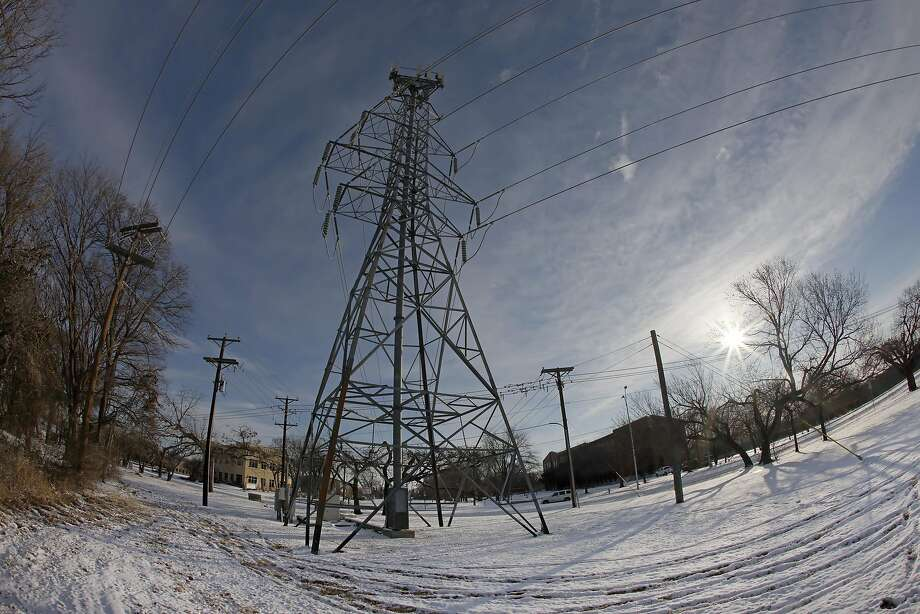 FORT WORTH, TX - FEBRUARY 16: A transmission tower supports power lines after a snow storm on February 16, 2021 in Fort Worth, Texas. ERCOT officials stood by their decision to begin rotating outages early Monday morning and said they can't end controlled blackouts until the energy supply increases or they risk damaging the grid infrastructure. Photo: Ron Jenkins, Getty Images