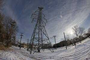 FORT WORTH, TX - FEBRUARY 16: A transmission tower supports power lines after a snow storm on February 16, 2021 in Fort Worth, Texas. Winter storm Uri has brought historic cold weather to Texas as storms have swept across 26 states with a mix of freezing temperatures and precipitation. (Photo by Ron Jenkins/Getty Images)
