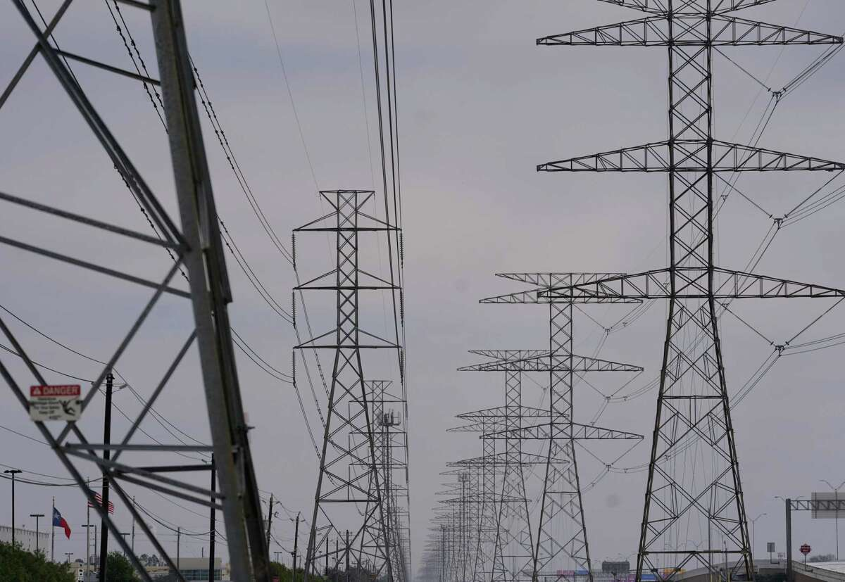 Power lines are shown along the North Sam Houston Tollway near State Highway 249 Monday, February 15, 2021 in Houston.