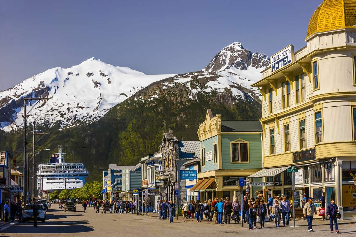 Cruise ship docked in background of Historic District of Skagway, Alaska.