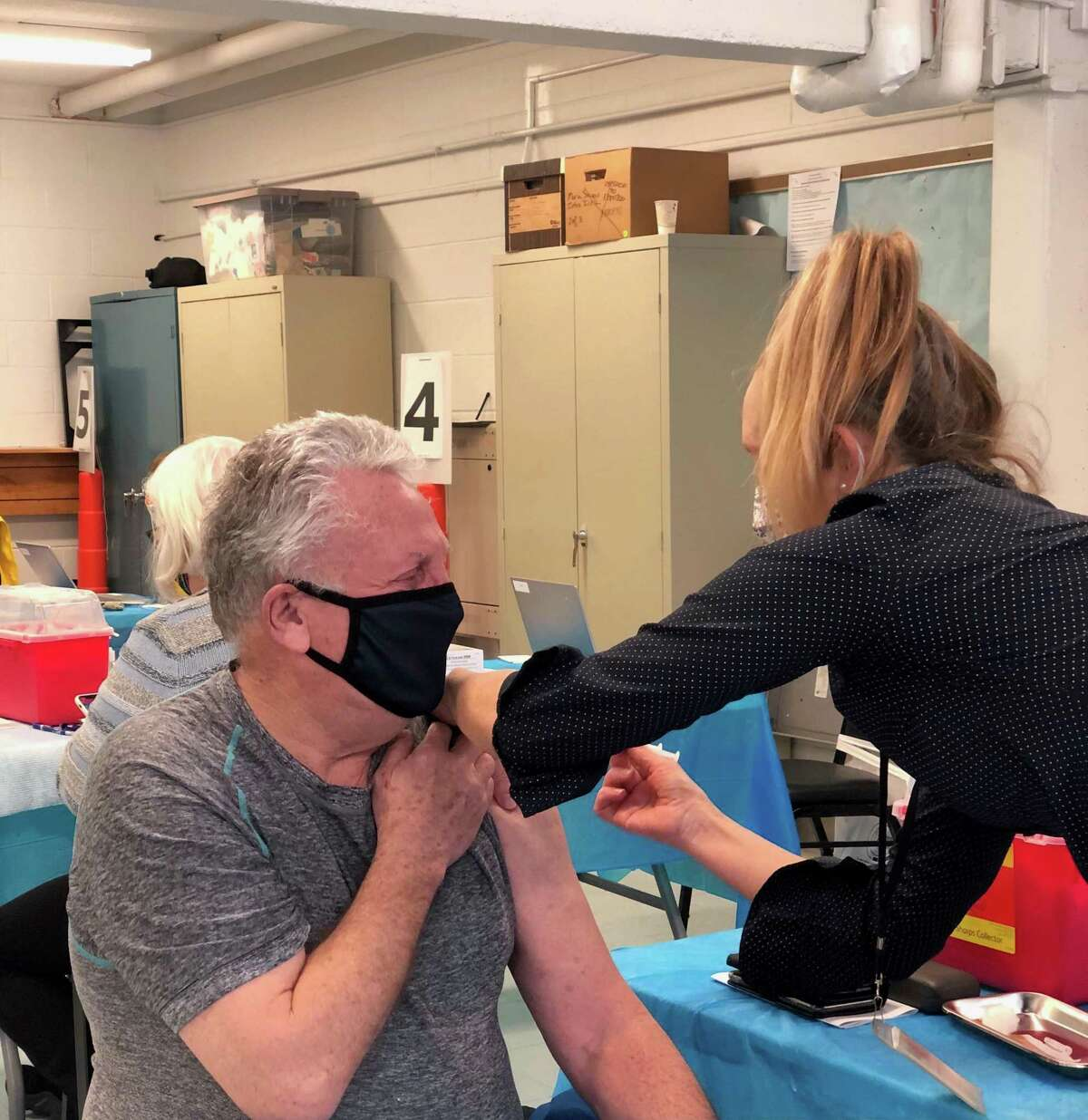 Norwalk Mayor Harry Rilling receives his first dose of the COVID-19 Moderna vaccine Tuesday, Feb. 16.
