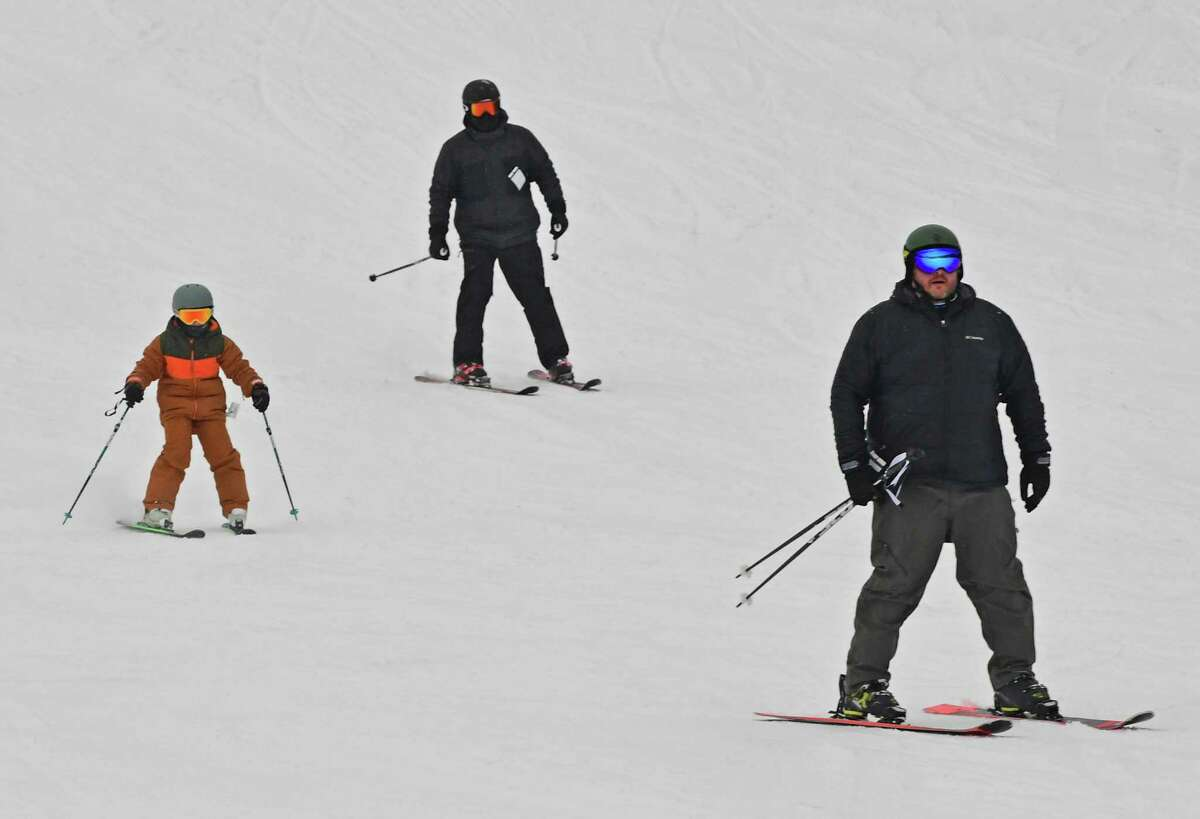 Skiers make their way down a slope at West Mountain ski area on Monday, Feb. 15, 2021 in Queensbury, N.Y. (Lori Van Buren/Times Union)