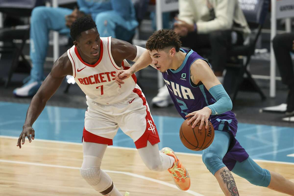 Charlotte Hornets guard LaMelo Ball, right, drives against Houston Rockets guard Victor Oladipo in a Feb. 8 game.