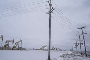 Pump jacks operate in the Permian Basin in Midland, Texas, U.S, on Saturday, Feb. 13, 2021. The arctic freeze gripping the central U.S. is raising the specter of power outages in Texas and ratcheting up pressure on energy prices already trading at unprecedented levels. Photographer: Matthew Busch/Bloomberg