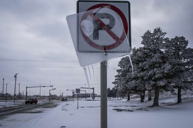 Ice coats a road sign in Midland, Texas, U.S, on Monday, Feb. 15, 2021. Blackouts triggered by frigid weather have spread to more than four million homes and businesses across the central U.S. and extended into Mexico in a deepening energy crisis that's already crippled the Texas power grid. Photographer: Matthew Busch/Bloomberg