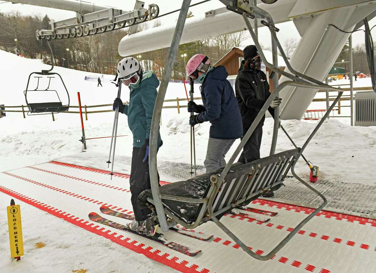Skiers board the chairlift at West Mountain ski area on Monday, Feb. 15, 2021 in Queensbury, N.Y. Ski areas in New York - as well as neighboring Massachusetts - are reporting a good 2020-21 snow season as people decided to recreate close to home. (Lori Van Buren/Times Union)