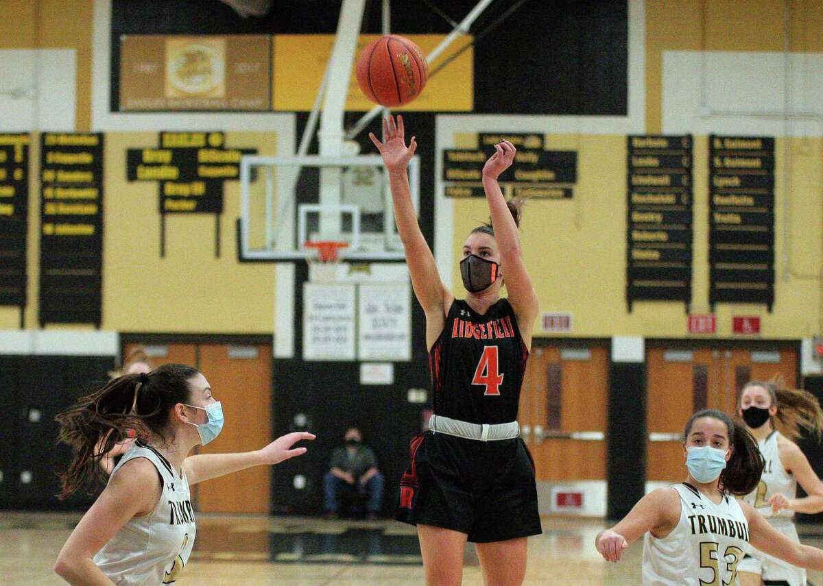 Ridgefied's Katie Flynn (4) releases a jump shot during girls basketball action against Trumbull in Trumbull, Conn., on Wednesday Feb.10, 2021.