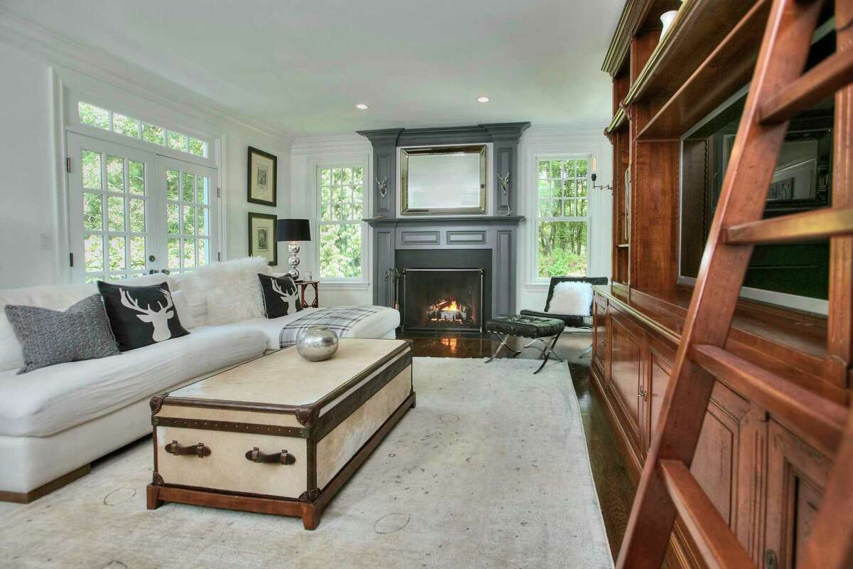 Formal living room with gas log fireplace at 5 Mayflower Parkway, Westport.