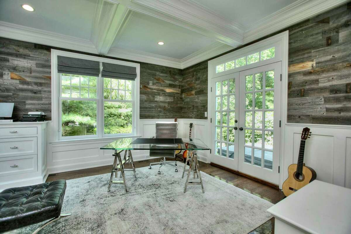 Library or office with French doors to a patio at 5 Mayflower Parkway, Westport.