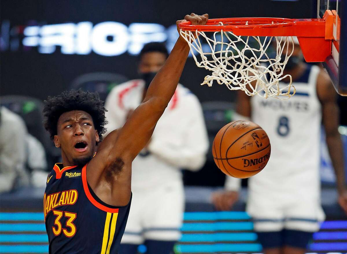 Warriors' rookie center James Wiseman dunks for two of his 25 points against Minnesota in the fourth quarter of the Warriors' 123-111 win on Jan. 27.