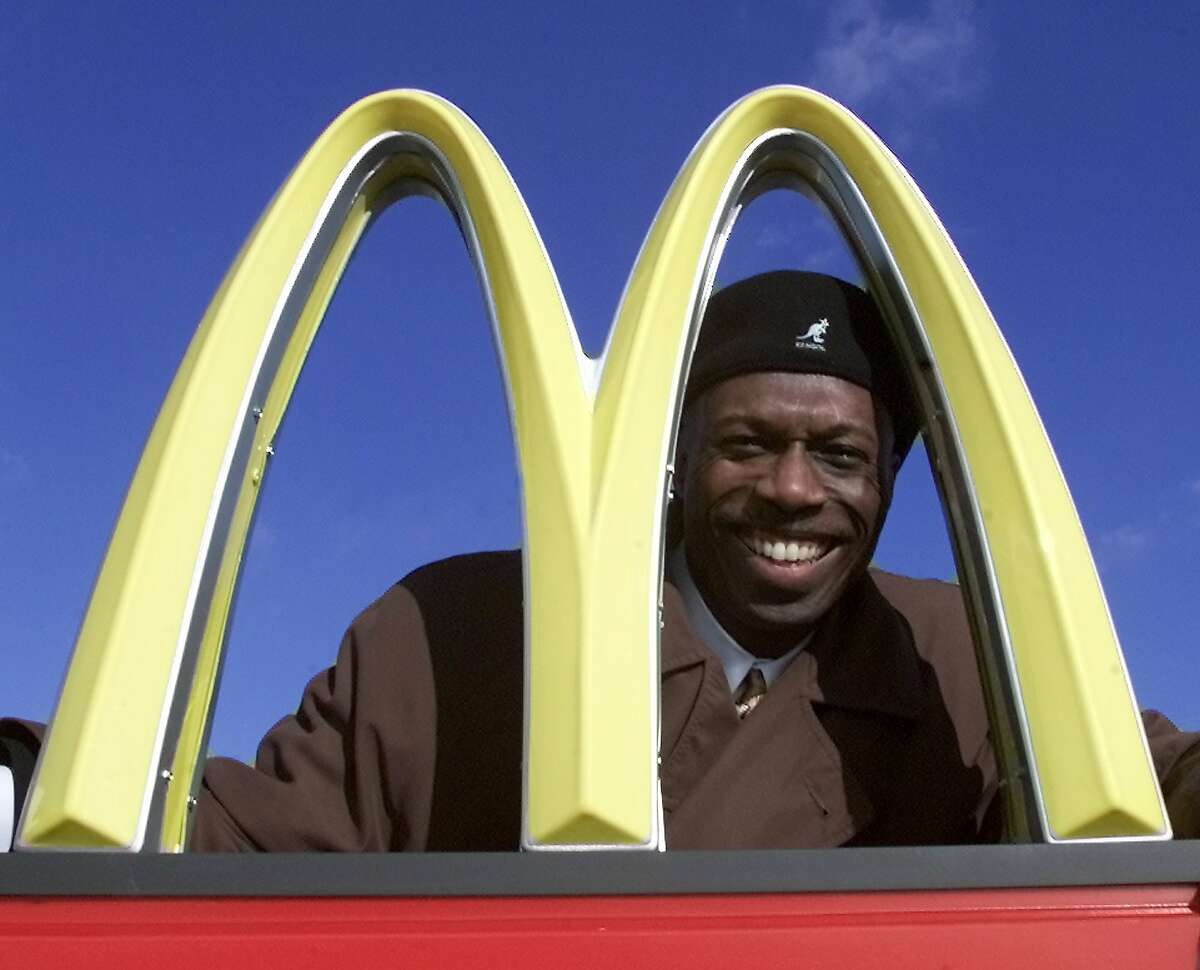 Herb Washington poses for a portrait outside his McDonalds restaraunt in Niles, Ohio, Thursday, Jan. 3, 2002. Washington, the Black owner of 14 McDonald's franchises in Ohio has sued the corporation in federal court asserting numerous instances of unfair treatment compared with white owners. Washington in his lawsuit filed Tuesday, Feb. 16, 2021 says the Chicago-based company has steered him over the years into buying franchises in low-income, majority Black communities while denying him the chance to buy stores in more affluent white locations. (AP Photo/Ron Schwane)
