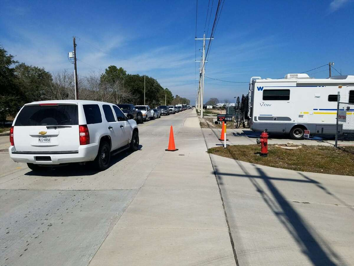 Vehicles of waiting customers back down the road for as far as can be seen outside a propane business on Calder Road in League City.