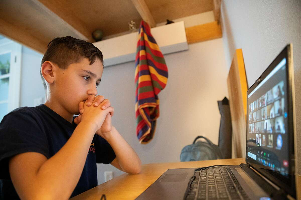 Senan Dokken, 9, at home during his online drama class on Thursday, Feb. 11, 2021, in San Francisco.