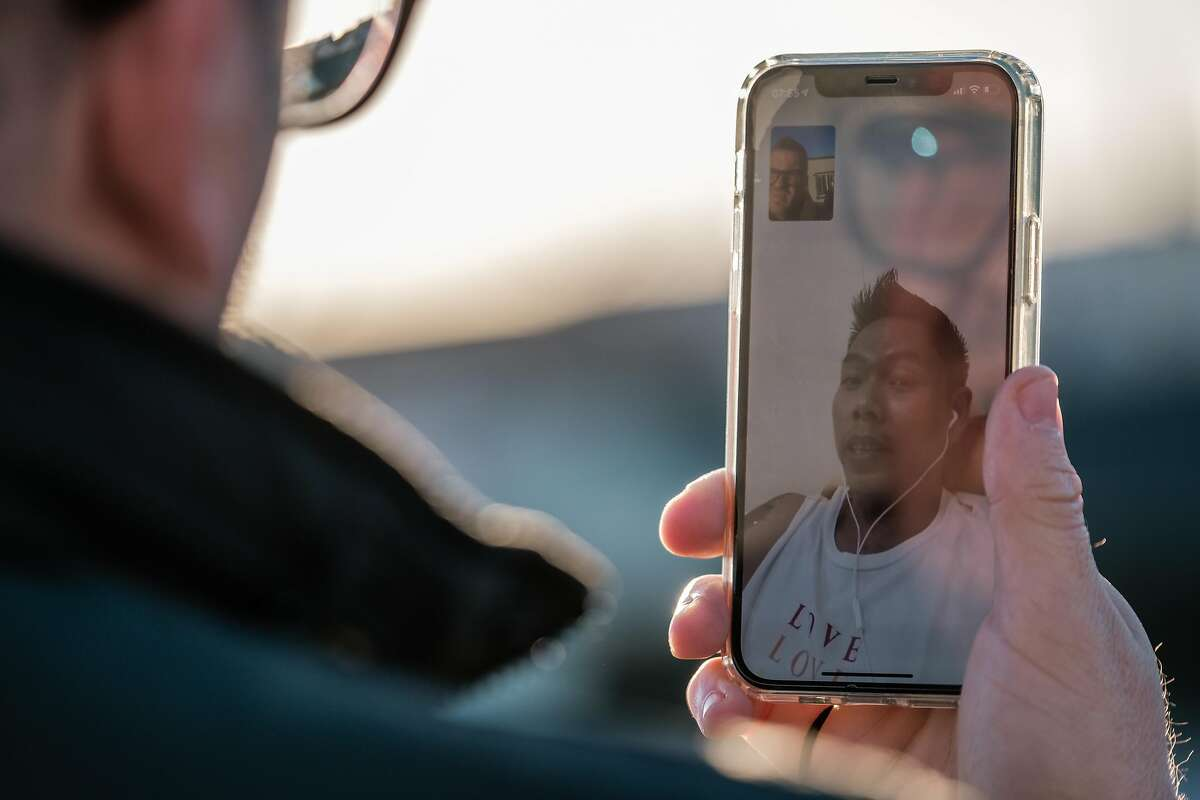 Kenny Kruse video chats with his fiance Yar Zar Min from his home in San Francisco on Friday, Feb. 12, 2021. Yar Zar Min is currently in Myanmar, where a military coup has complicated the couple's efforts to reunite.