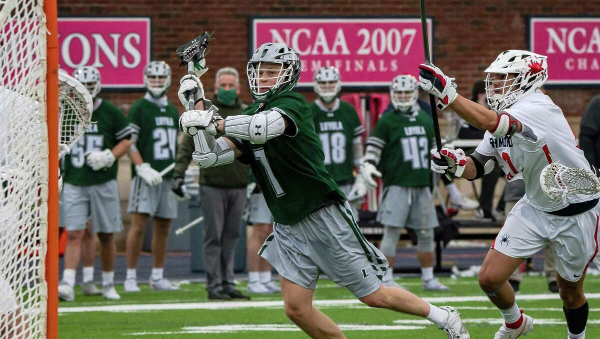 Loyola University Maryland's Kevin Lindley shoots and scores one of his three goals against the University of Richmond on Feb. 14, 2021, at the Spiders' Robbins Stadium. Lindley finished with three goals.