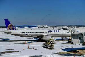 Aircraft are parked at San Antonio International Airport on Monday, Feb. 15, 2021, after inches of snow fell overnight. The airport is closed; it lacks sufficient equipment to make the runways and taxiways usable.
