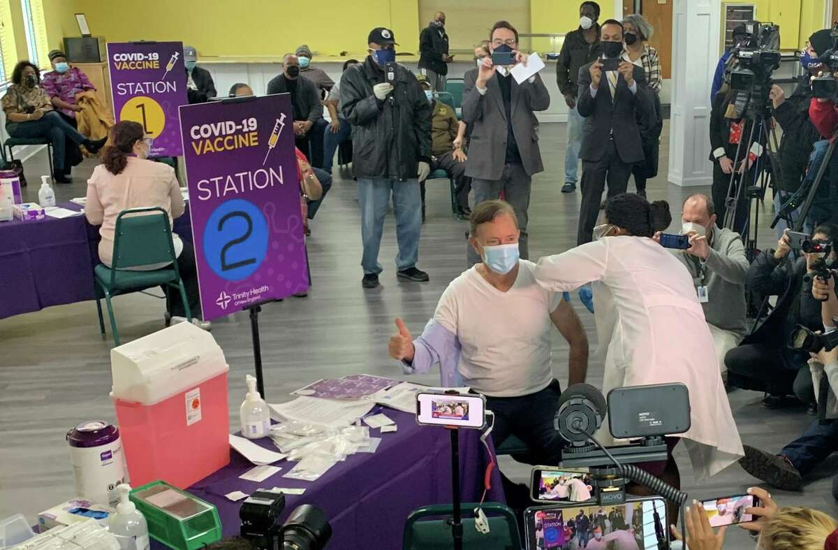 Gov. Ned Lamont was administered with his first dose of the Pfizer COVID-19 vaccine on Tuesday, Feb. 16, at the First Catholic Church in Bloomfield.
