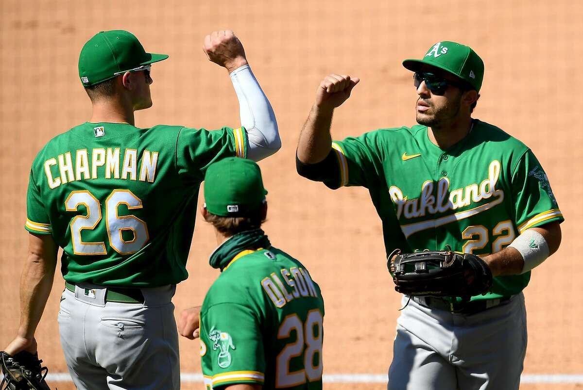 Matt Chapman, left, Matt Olson, center, and Ramón Laureano were among the handful of players named by A's manager Bob Melvin as likely clubhouse leaders this season.