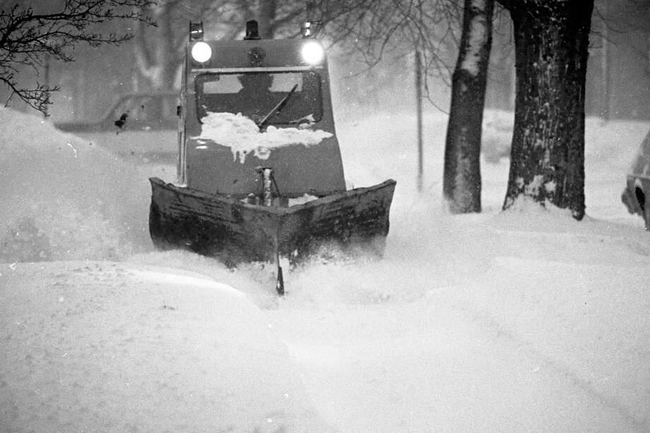 Tracked vehicles began plowing sidewalks in Manistee in 1981. Public Works Director Jeff Mikula said the city's sidewalk ordinance making residents responsible for maintenance has been in place for decades. (Manistee County Historical Museum photo)